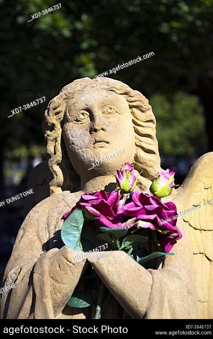 Europe, Luxembourg, Esch-sur-Alzette, Cemetière St Joseph (Saint Joseph Cemetery) with Statue of Angel clutching Flowers