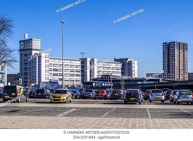 Cars parked in front of the Clock Building at Strijp-S, Eindhoven, The Netherlands