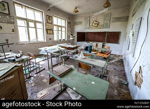 Classroom with a blackboard in old secondary school in Mashevo abandoned village of Chernobyl Nuclear Power Plant Zone of Alienation in Ukraine
