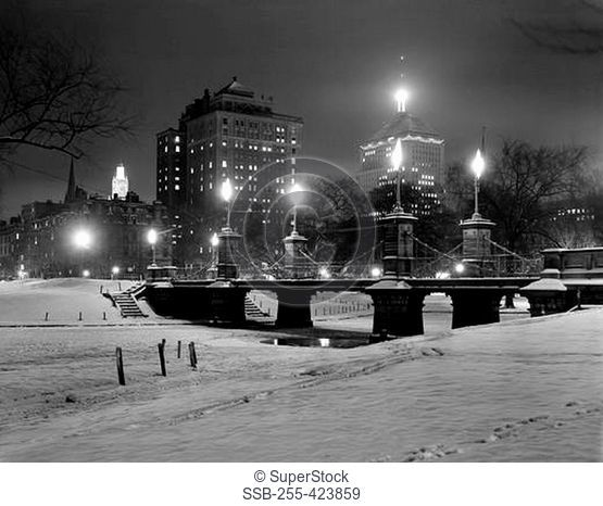 USA, Massachusetts, Boston, Bridge and buildings illuminated by night