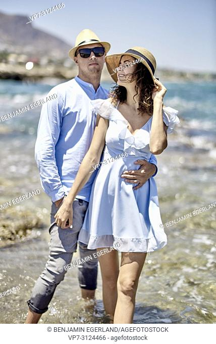 couple at beach in Hersonisssos, Crete, Greece