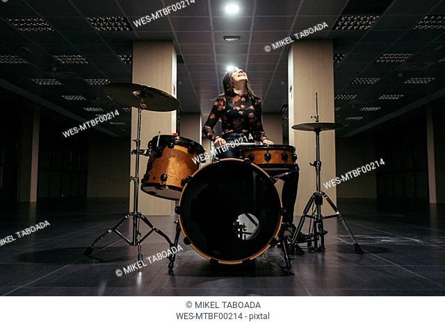 Passionate oman playing drums