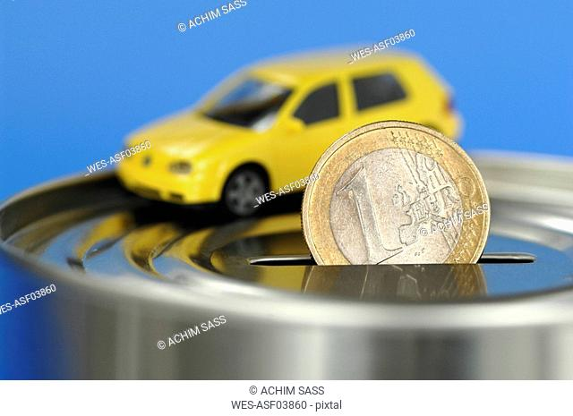 Toy car on money box