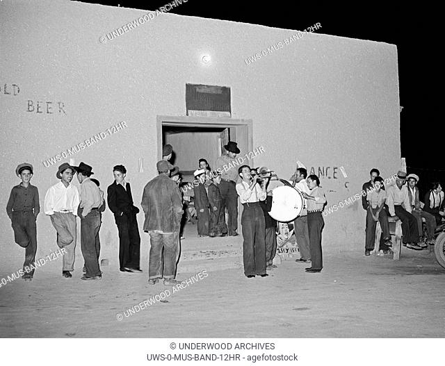 Penasco, New Mexico: July, 1940 A traveling Hispanic band playing outside a bar and dance club