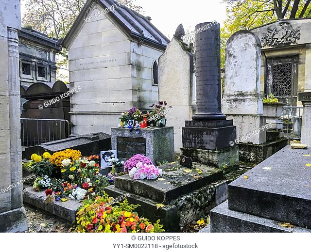 Paris, France. Pere Lachaise Cementery with grave of Doors singer Jim Morrison, who died on July 3, 1971. The monument still attracts lot of visitors and fans