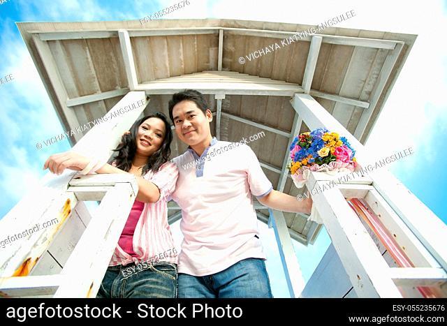 portrait of romantic couples at lighthouse