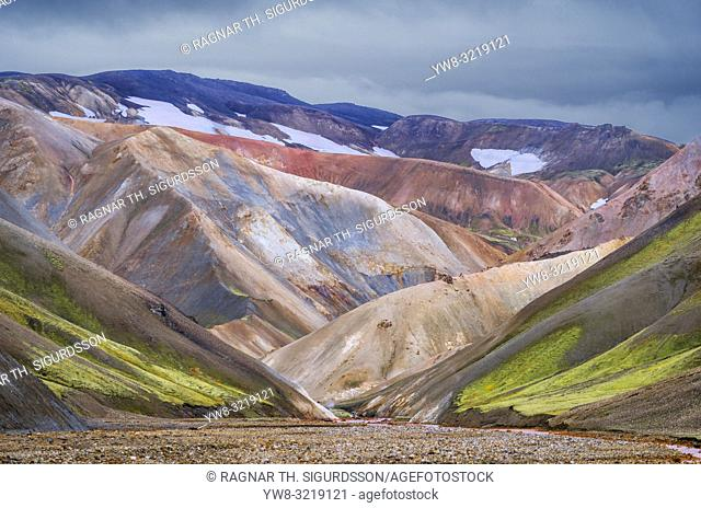 Aerial-Jokulgilskvisl River and Mountain Peaks, Landmannalaugar, Iceland. The area is known for unusual geological elements such as multi-colored rhyolite
