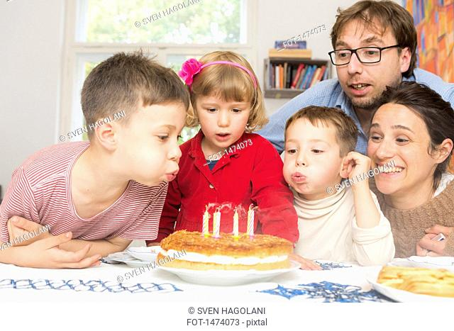 Family celebrating birthday at home