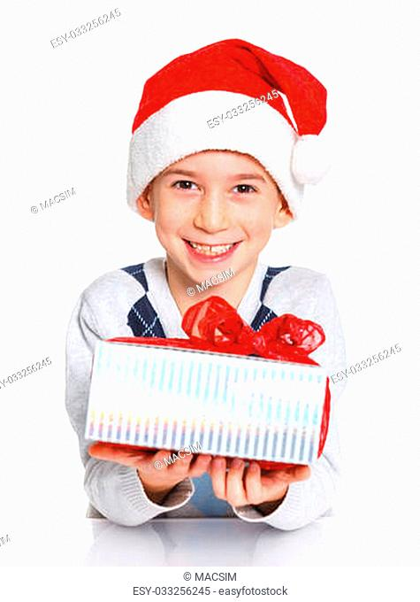 Christmas theme - Closeup portrait of smiling boy in Santa's hat with gift box, isolated on white