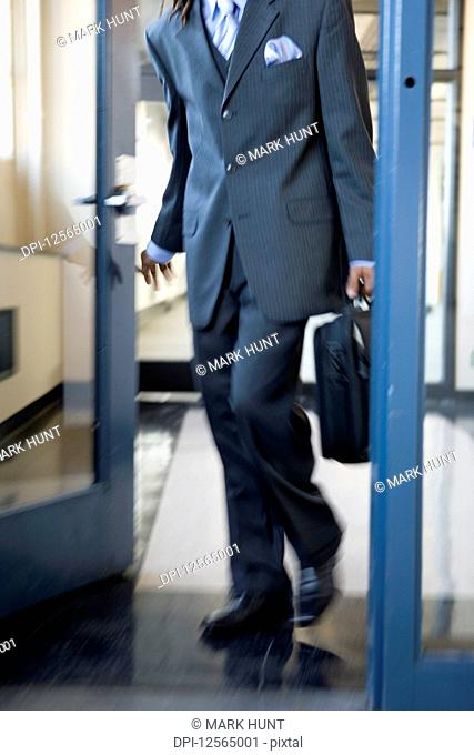 A young Business man opening the door