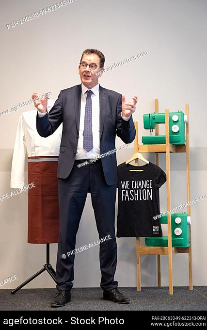 """30 June 2020, Hamburg: Federal Development Minister Gerd Müller (CSU) speaks at a press conference on the """"""""Green Button"""""""" textile label at the Dorint Hotel in..."""