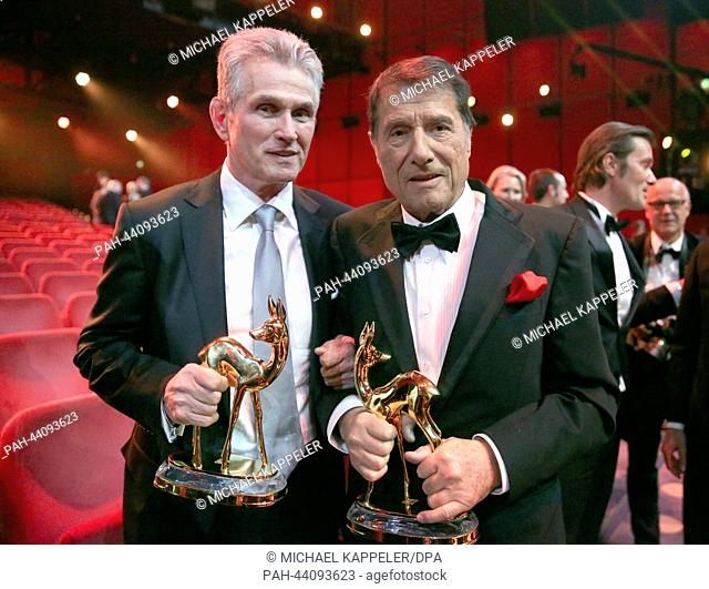 Awardees Udo Juergens (R) and Jupp Heynckes pose with their Bambi awards at the 65th Bambi award ceremony at the Stage Theater in Berlin, Germany
