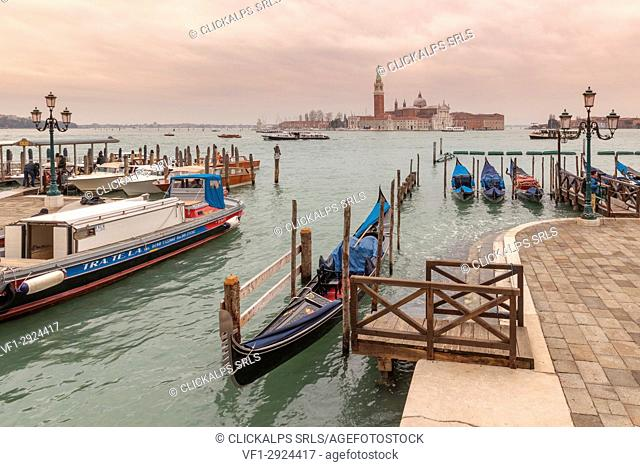 Europe, Italy, Veneto, Venice. View on the Canal Grande with boats and gondolas, on the background San Giorgio island