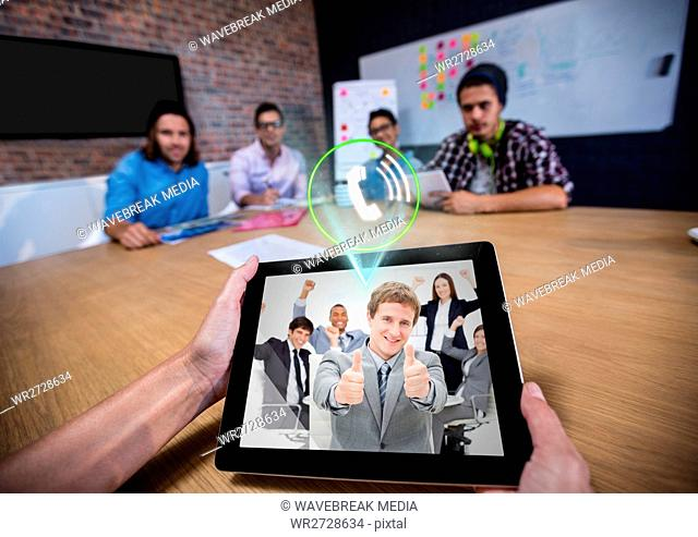 Man having a video with his colleagues on digital tablet