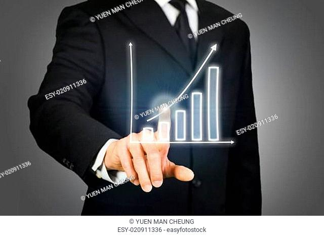 Businessman clicking on a rising chart