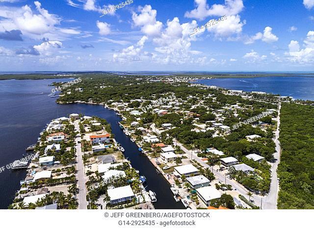 Florida, Florida Keys, Upper, Key Largo, Largo Sound, Blackwater Sound, homes, residences, aerial overhead view above bird's eye