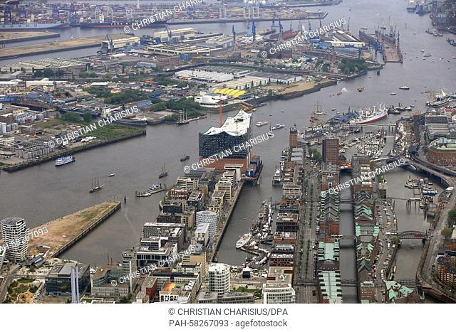 The construction site of the Elbe Philharmonic Hall (C) with parts of the Hafencity quarter and Speicherstadt, the warehouse district, in Hamburg, Germany