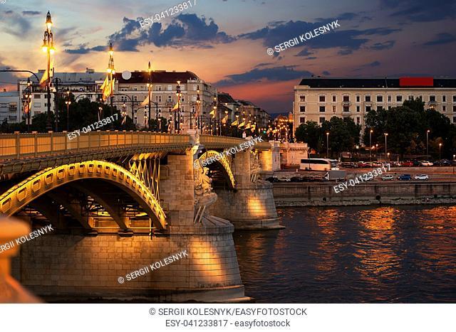 Illuminated Margaret Bridge on Danube river in Budapest