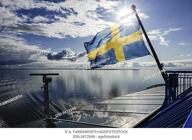 Turku, Finland, A Swedish flag flies over the stern of a ferry boat