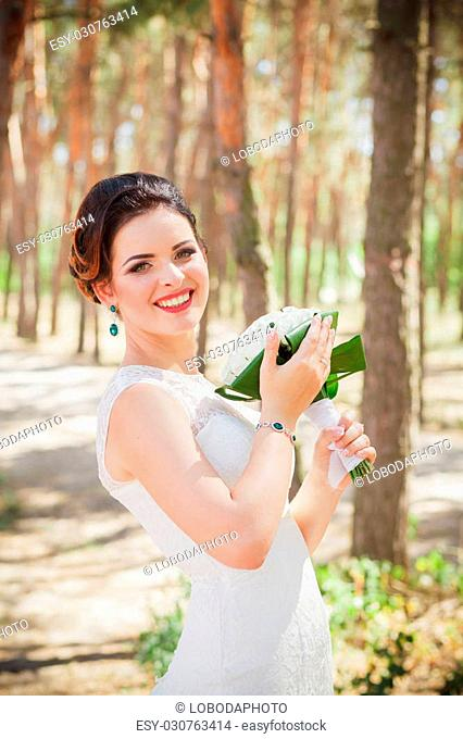 retro bride alone in forest summer