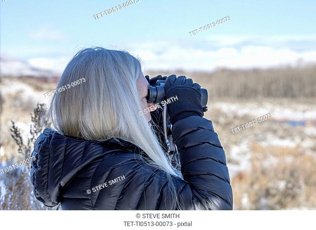 Woman using binoculars