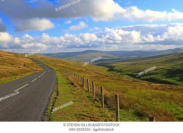 Road by Gayle Moor with Ingleborough in the far distance, Yorkshire Dales, England, UK
