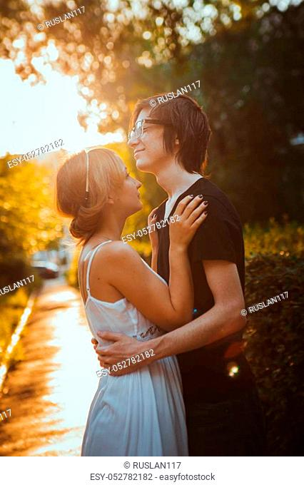 guy and the girl embracing on a background of park