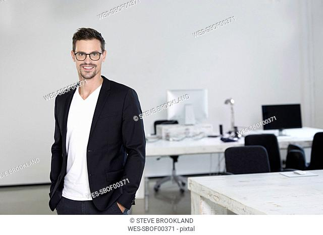 Portrait of a young businessman in his office