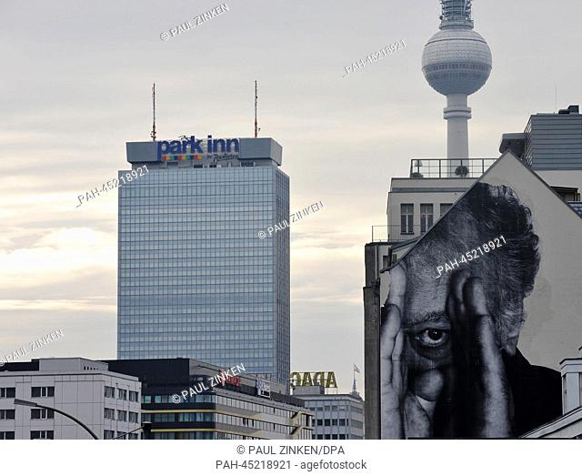 A large mural by French street artist JR is pictured on a building on Prenzlauer Allee in Berlin, Germany, 02 January 2013