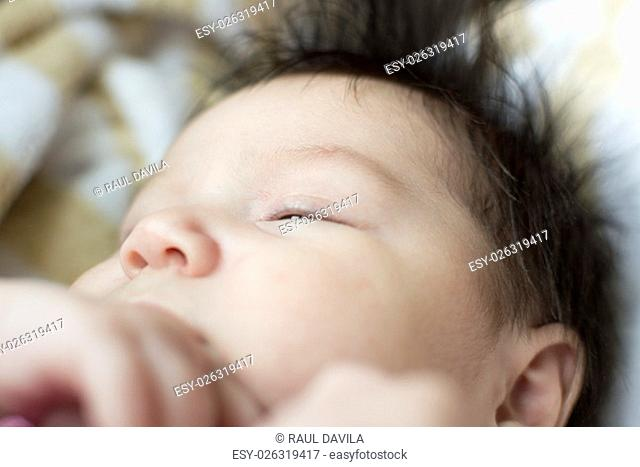 Detail half the face of a newborn baby