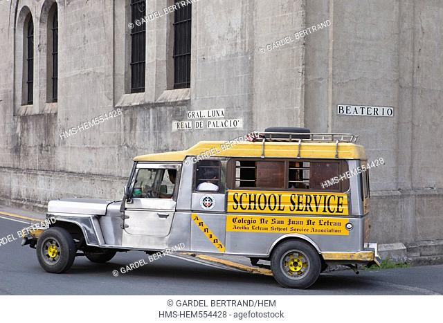 Philippines, Luzon island, Manila, Intramuros historic district, a jeepney passes through the old city