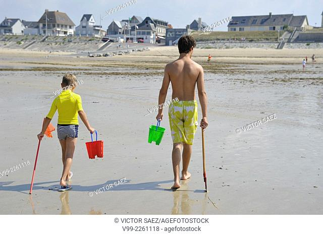 France, Normandy, Man and boy on beach