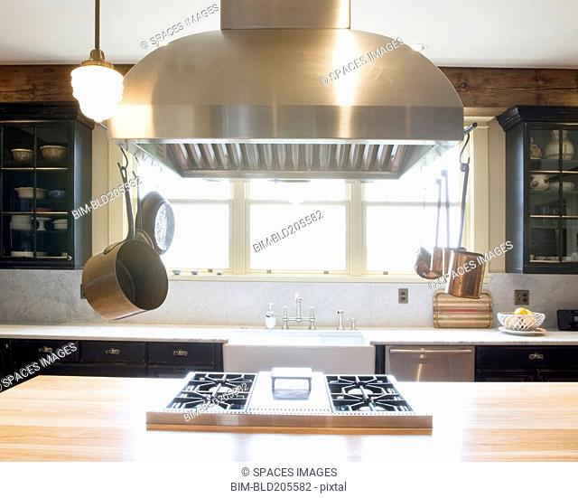 Stainless steel hood over stove in luxury kitchen