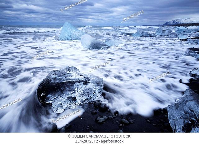 Iceland, Austurland region, Vatnajokull National Park, Jokulsarlon, icebergs and chunks of ice on black sand beach