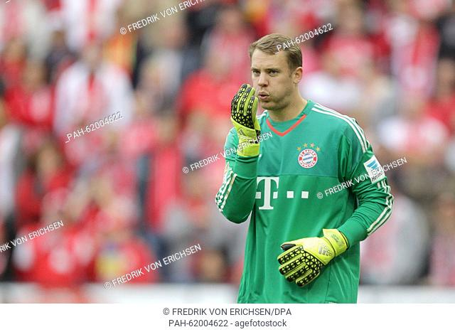 Munich's goalkeeper Manuel Neuer blowing dust off his gloves. Mainz lost the game 0:3 of the German Bundesliga soccer match between 1
