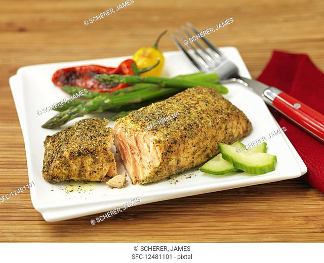 Salmon in a spice coating with vegetable garnish
