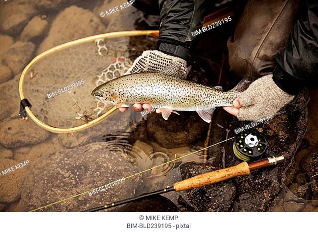 Caucasian man showing caught fish