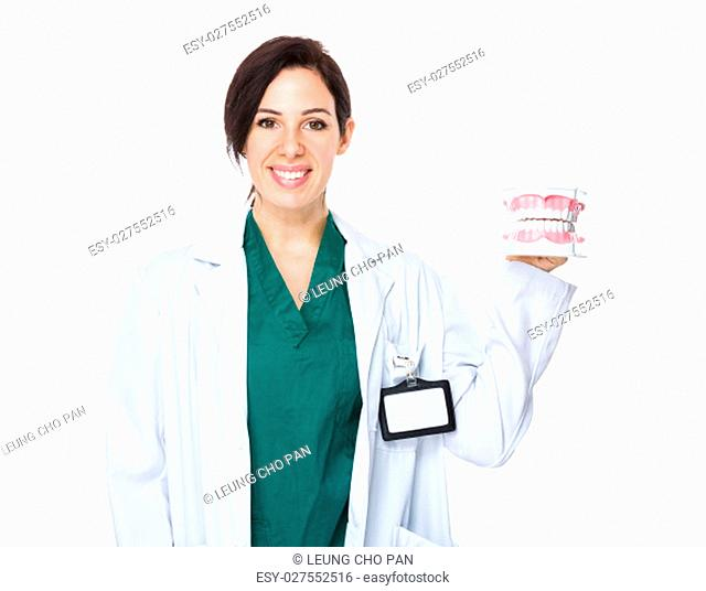 Dentist showing with denture