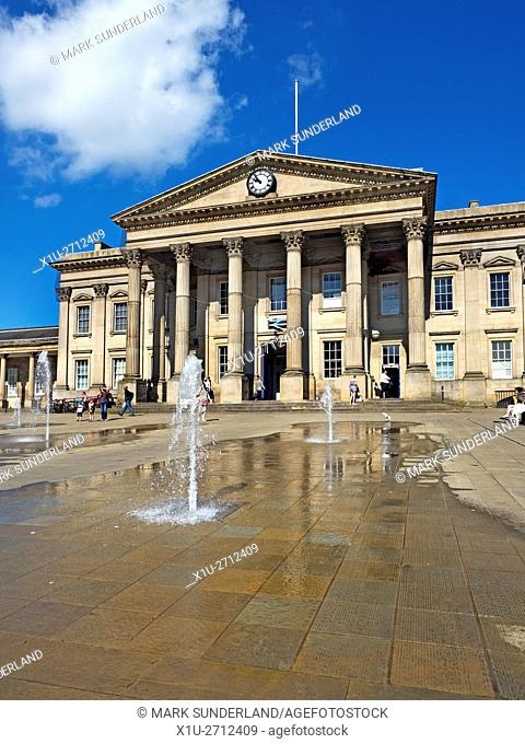 Fountains in front of the Railway Station in St Georges Square Huddersfield West Yorkshire England