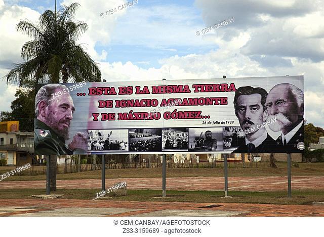 Poster with revolutionary propaganda of the Cuban heros like Fidel Castro, Maximo Gomez and Ignacio Agramonte in Plaza de la Revolucion at the city center