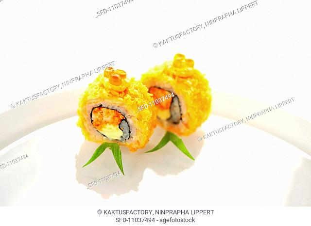 Fried salmon maki sushi with shrimps and cream cheese