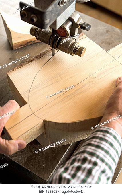 Cutting a wooden block using a band saw, wooden mask carver, Bad Aussee, Styria, Austria