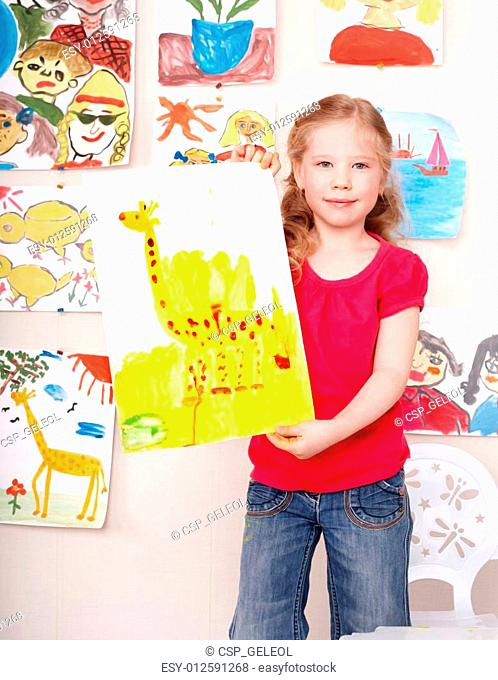 Child with picture and brush in play room