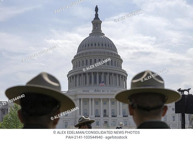 Law enforcement officers look on during the the 37th Annual National Peace Officers' Memorial Service on the West Front of the United States Capitol Building in...