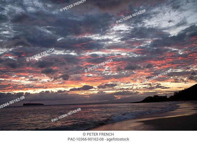 Hawaii, Maui, Makena State Park, Oneloa or Big Beach, water lapping onto shore at sunset