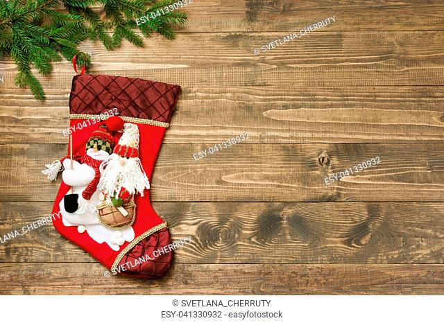 Christmas fir tree, red Christmas socks on the wooden background. Top view, copy space