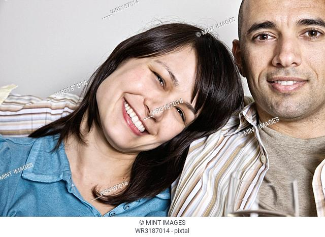 View of Hispanic woman and man in their home