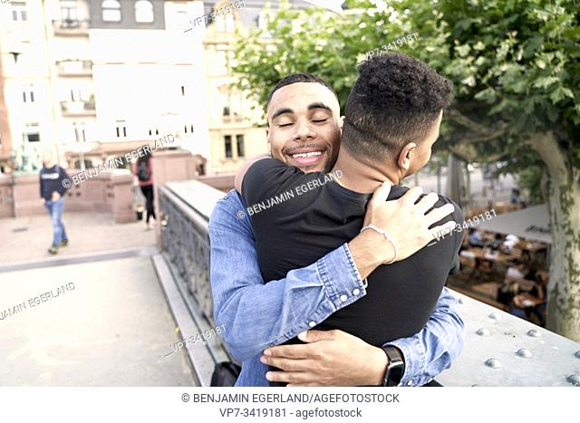 Gay couple embracing. Frankfrut am Main, Germany