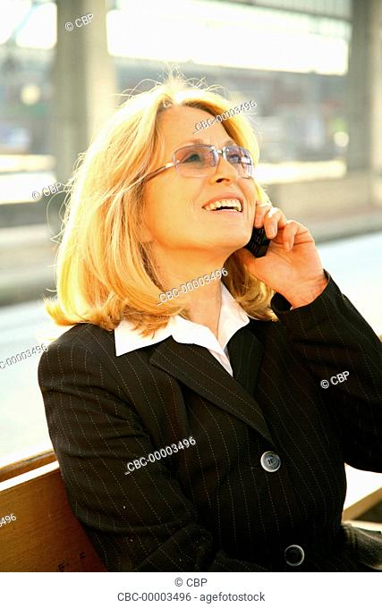 Mature Business Woman Using A Mobile Phone