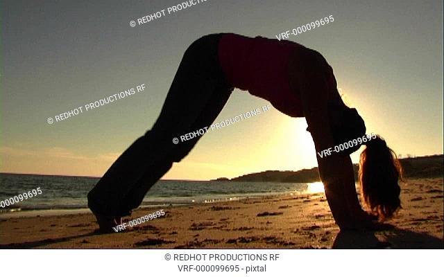 Woman on beach doing exercises